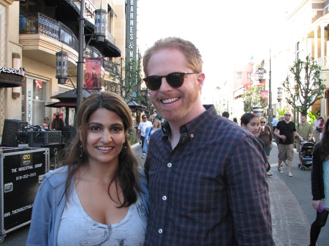 Jesse Tyler Ferguson poses with fan while Modern Family shoots on location