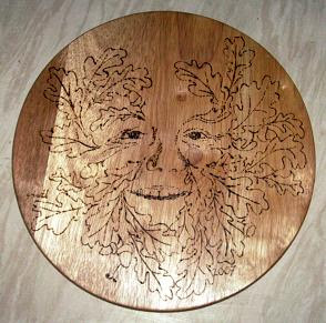 green man pyrograph chopping board