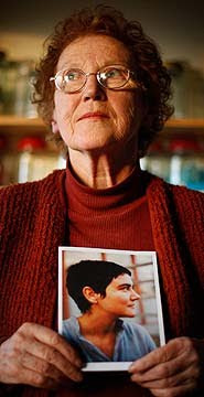 Criona Wilson with a picture of Sophia, who died of ME aged 32