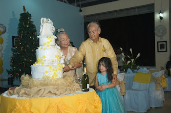 Dave and Macrine with Carenna Cutting the Cake