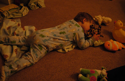 sleeping arrangements involved a little dude face-down on the family room floor