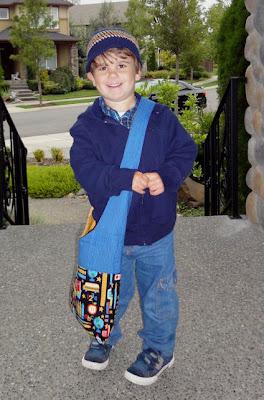 a happy boy and his school bag