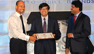 Prof A. Sandeep (left) & Mr. S. K. Shetty (right) giving away the Best Automobile Awards for Maruti Swift, Alto & Wagon R to Mr. Mayank Pareek, Chief GM-Marketing, Maruti Udyog Ltd. (center)