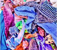 Messy pile of colorful clothes. KandyJaxx on flickr