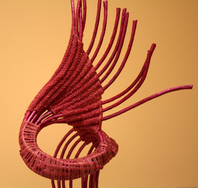 sculptural piece made with tubular knitting and sticks, made by Passle Helminski, blind since 15 years old, with Bilateral Cortical Dipolopia Palinopsia