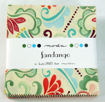 little stack of 5x5 fabrics, top fabric is cream background with brown, green, blue and red floral design, label says Fandango by Kate Spain for Moda