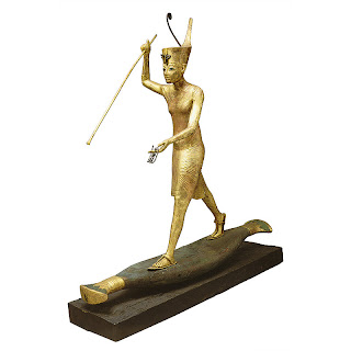 Gilded statue of Tutankhamun hunting on a papyrus skiff