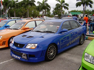 Modified Waja Evo 7 with HKS Extreme car sticker.