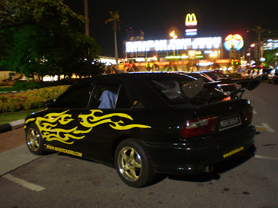 Wira A/B with car body sticker and GT spoiler