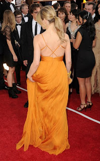 Kyra Sedgwick Lovely In A Brilliant Mustard Gown And All Gold Accessories