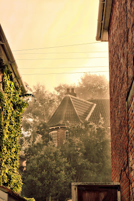 very pretty looking house on a misty morning