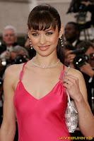 Olga Kurylenko sexy silk pink dress