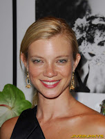 Amy Smart in a silk black dress
