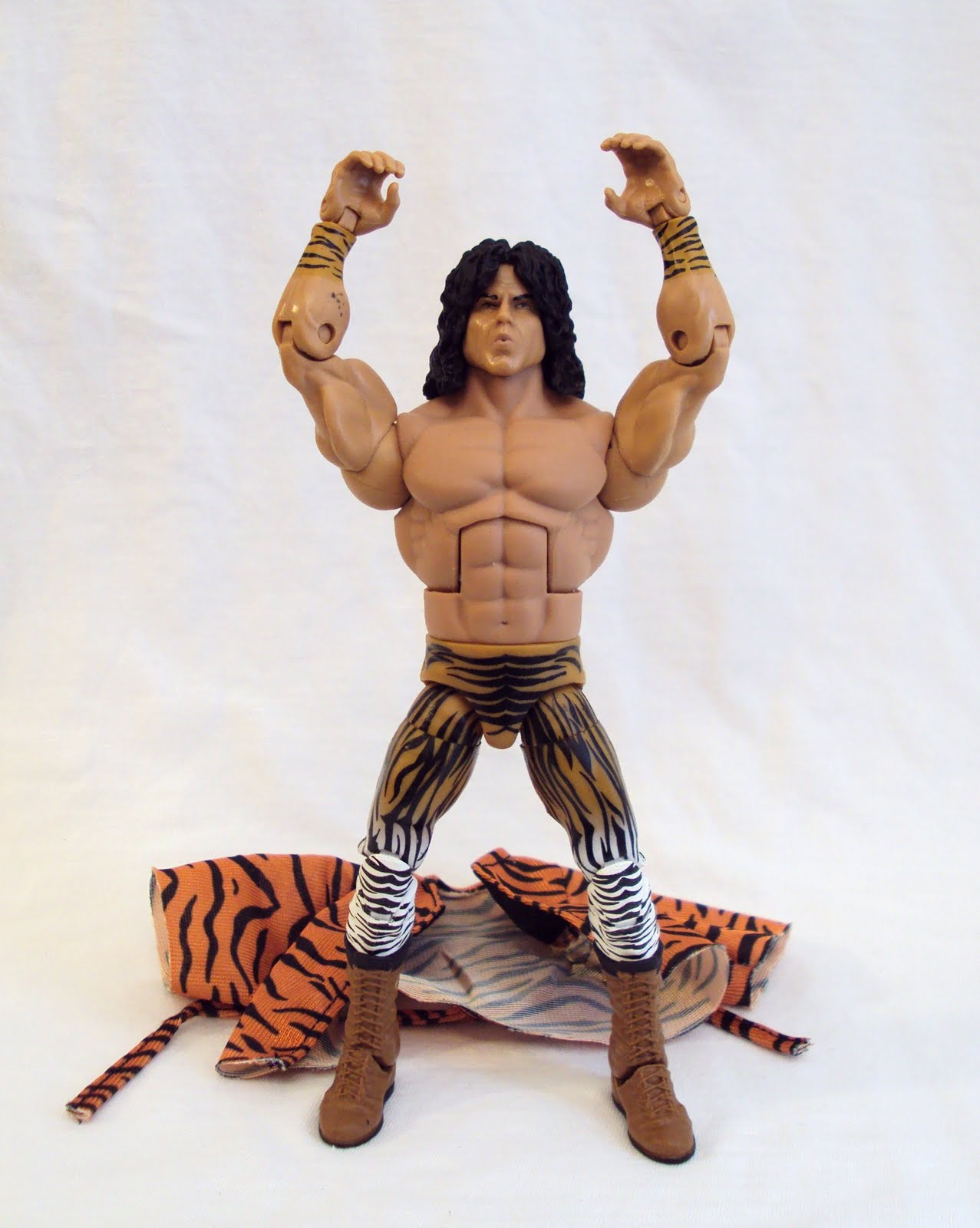 the paint on him is impressive with the tiger pattern spread across his tights and wrists his skin is molded in the correct color as is his hair