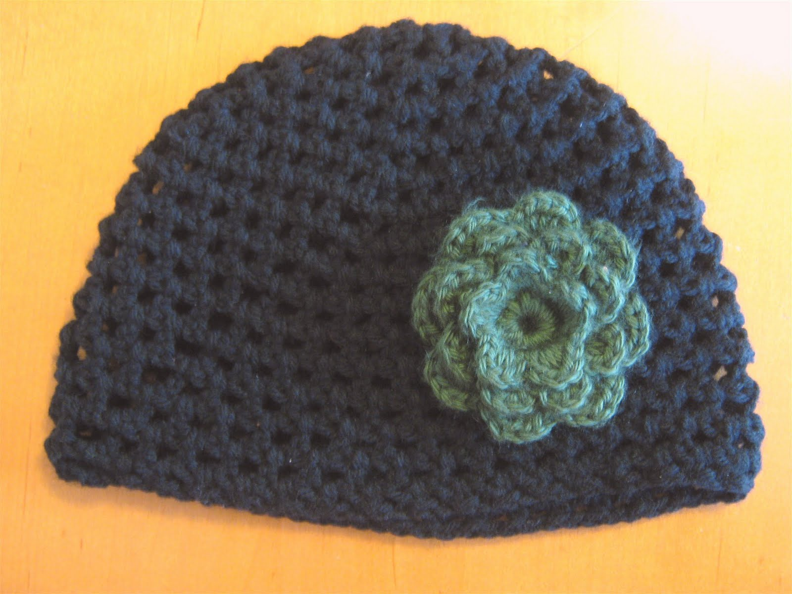 Crochet Flower For Hat : ... black crocheted hat with a green crocheted flower on it it was a gift