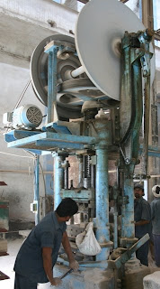 Operator running a Friction Screw Press (FSP) image
