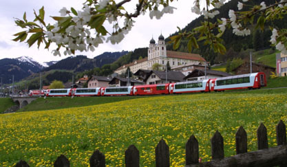 The Glacier Express przez  Convent in Disentis