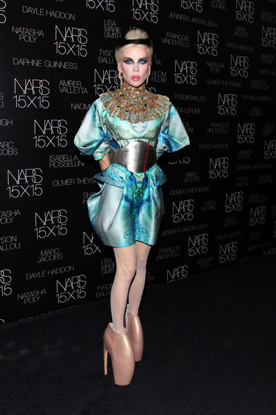 The always-dramatic Gaga dons a sequined pair of the 12 inch heels in the