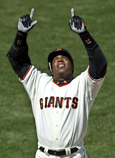 Barry Bonds with two hands skyward