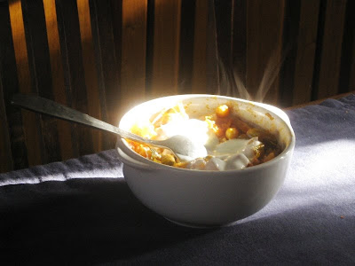 Bowl of chickpeas with dollop of yogurt and steam rising