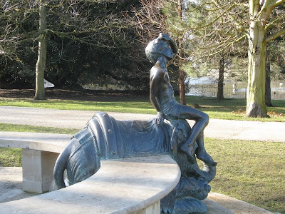 Statue of boy on elephant in the park