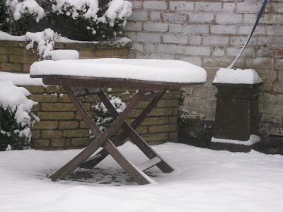 Garden table with 4 inches of snow
