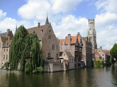 View of canal, houses and the Belfort