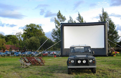 Screen and Landrover, with pub in background