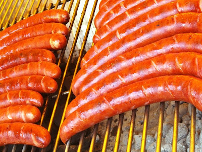 Sausages cooking on a grill
