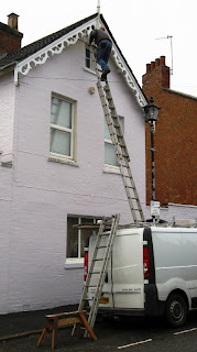 Ladders from the roof of the van to the top of the gable