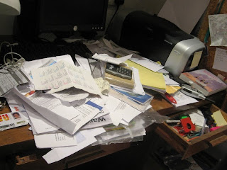 A desk covered in papers