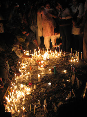 People light candles for those who lost their lives during the attacks
