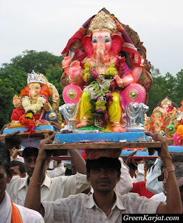 locals carrying Ganesh idols for immersion