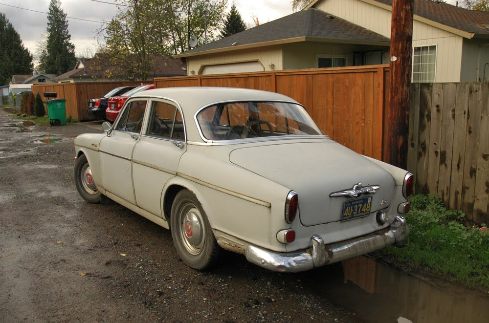 OLD PARKED CARS.: Road Not Improved, #1 of 2: 1962 Volvo 122s.