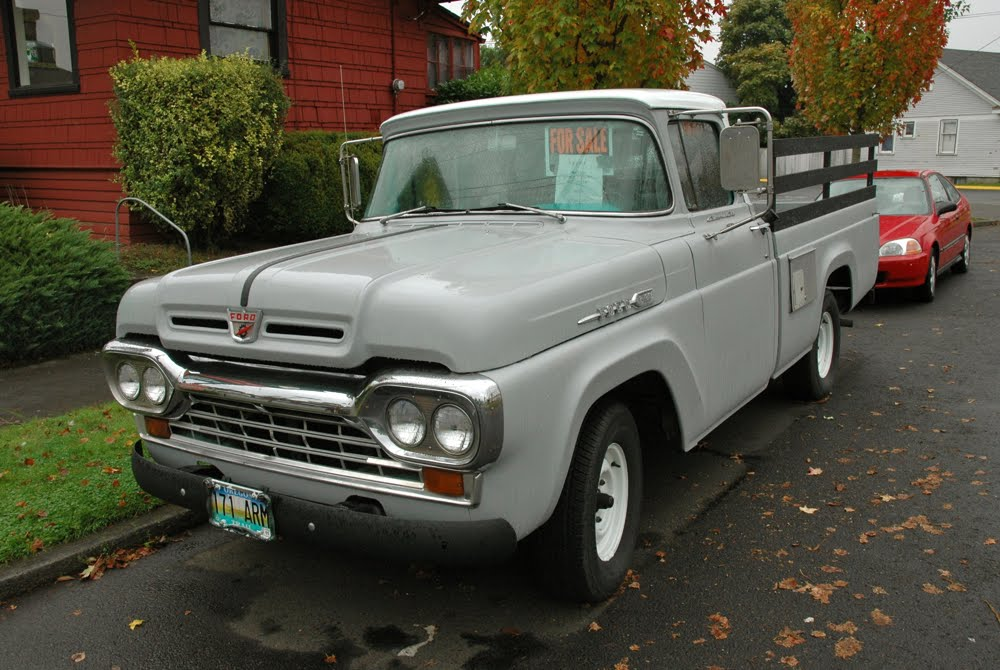 OLD PARKED CARS.: 1960 Ford F100.