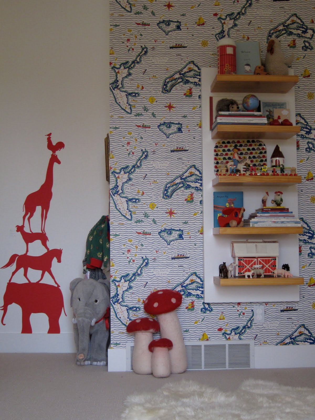 The wallpaper is Ralph Lauren, the wall sticker is animal tower from Ferm