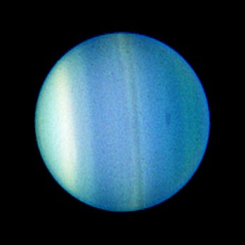 Uranus and one of its five major moons Ariel