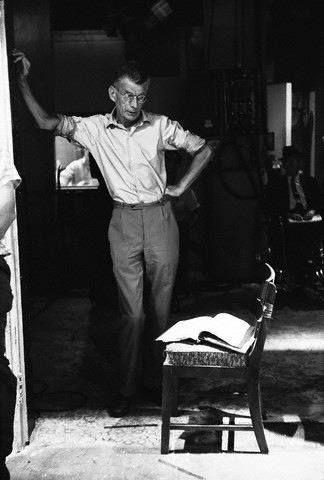 Samuel Beckett stands on the set of 'Film'