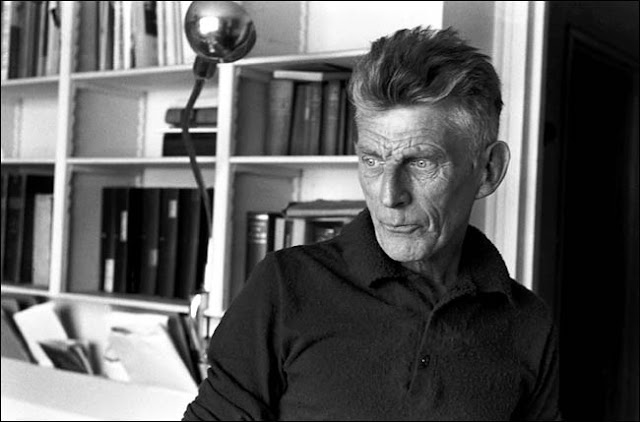 Samuel Beckett sitting in the study of his apartment in Paris. Photograph by Henri-Cartier Bresson