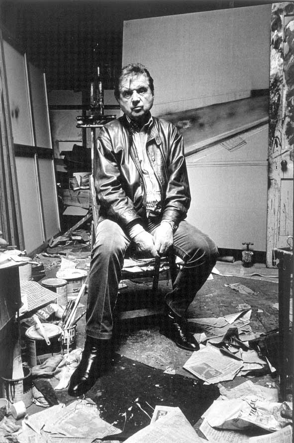 Francis Bacon in his studio, seated. Photograph by Beldam