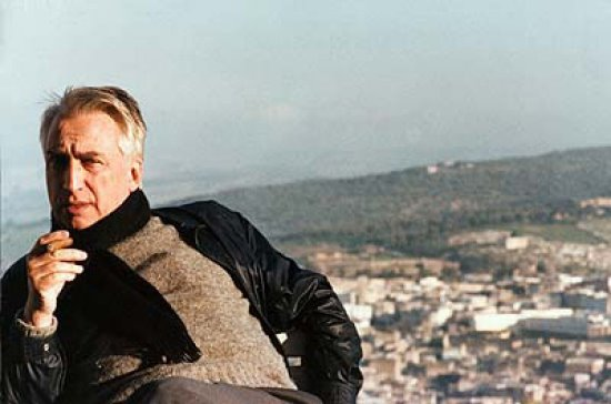 Roland Barthes sitting outside, smoking.