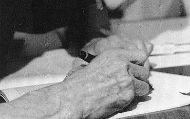 Samuel Beckett's hands, signing a manuscript