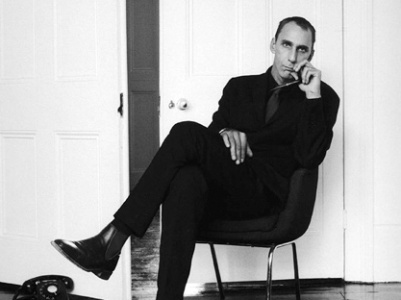 British writer Will Self sitting on a chair