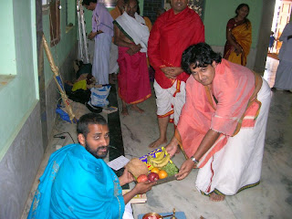 Shri Subhash Badri giving away sambhavane to Shri Sukeshachar Jalihal