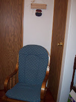 Squeezed in a rocking chair between the doorway and closet