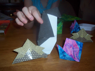 (Japan) A 'stab' at Origami.  A Viking hat, penguin and tropical fish