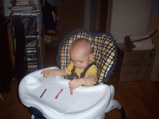 Baby drawing with crayons