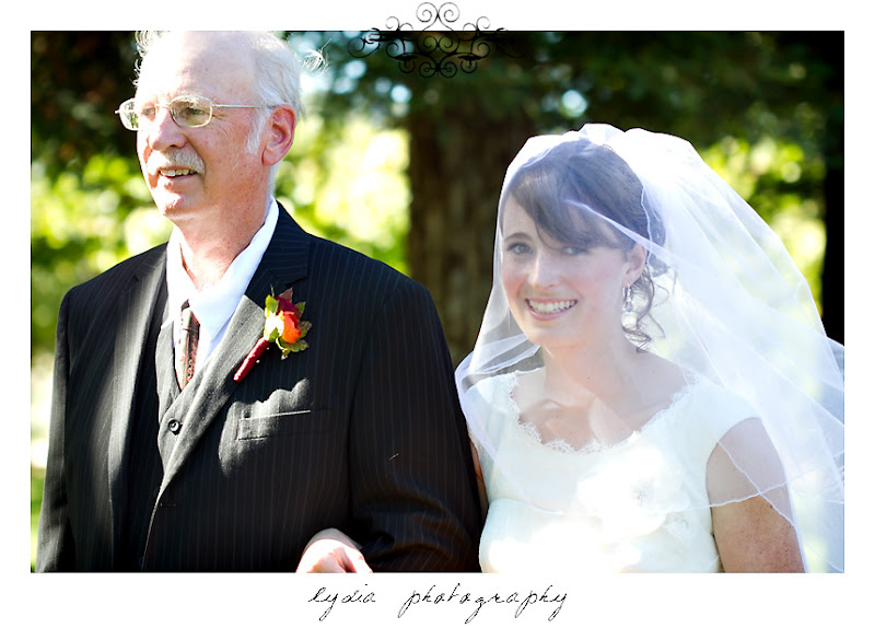 The bride and her father coming down the aisle at a Kenwood Farms & Gardens wedding