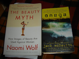 The covers of Naomi Wolf's The Beauty Myth and Jack McDevitt's Omega