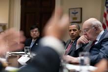 Barak Obama listens